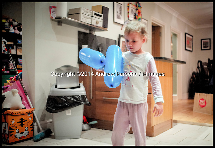Image ©Licensed to i-Images Picture Agency. 30/10/2014. London. Yasmin Parsons, 4, Plays with a balloon . Picture by Andrew Parsons / i-Images