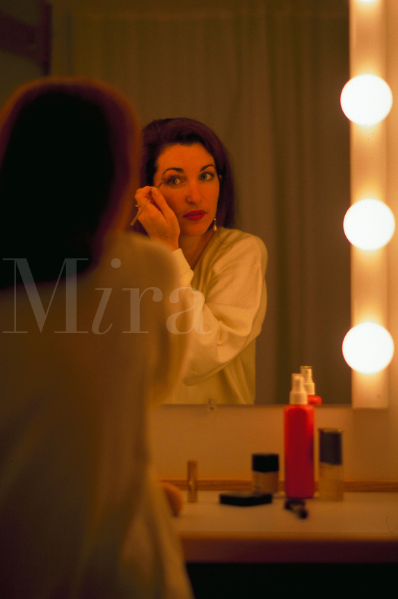 Woman applying makeup.