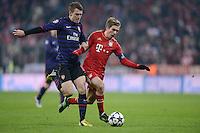 FUSSBALL  CHAMPIONS LEAGUE  ACHTELFINALE  HINSPIEL  2012/2013      FC Bayern Muenchen - FC Arsenal London     13.03.2013 Aaron Ramsey (li, Arsenal) gegen Philipp Lahm (re, FC Bayern Muenchen)