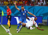 Dimitrios Salpingidis of Greece and Junior Diaz of Costa Rica in action