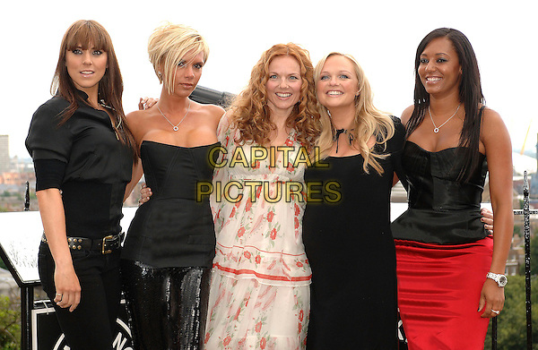 THE SPICE GIRLS.Posh (Victoria Beckham), Sporty (Melanie Chisolm), Ginger (Geri Halliwell). Baby (Emma Bunton) and Scary (Melanie Brown) known to millions around the world as The Spice Girls pose at a photocall ahead of the announcement that they will reform for a world tour, where they will peform all their greatest hits. .London, England, 28th June 2007..half length black top strapless corset tight sequined trousers leggings red skirt  cream floral layered floaty dress pregnant.CAP/ BEL.©Tom Belcher/Capital Pictures.