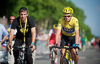 Chris Froome (GBR) chaperoned to the start by Team Sky press officer Dario Cioni<br /> <br /> Tour de France 2013<br /> (final) stage 21: Versailles - Paris Champs-Elysées<br /> 133,5km