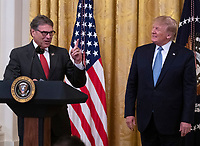 United States Secretary of Energy Rick Perry, left, makes remarks on America's Environmental Leadership as US President Donald J. Trump, right, listens in the East Room of the White House in Washington, DC on Monday, July 8, 2019. Photo Credit: Ron Sachs/CNP/AdMedia