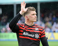 20130512 Copyright onEdition 2013©.Free for editorial use image, please credit: onEdition..Owen Farrell of Saracens thanks the fans after the Premiership Rugby semi final match between Saracens and Northampton Saints at Allianz Park on Sunday 12th May 2013 (Photo by Rob Munro)..For press contacts contact: Sam Feasey at brandRapport on M: +44 (0)7717 757114 E: SFeasey@brand-rapport.com..If you require a higher resolution image or you have any other onEdition photographic enquiries, please contact onEdition on 0845 900 2 900 or email info@onEdition.com.This image is copyright onEdition 2013©..This image has been supplied by onEdition and must be credited onEdition. The author is asserting his full Moral rights in relation to the publication of this image. Rights for onward transmission of any image or file is not granted or implied. Changing or deleting Copyright information is illegal as specified in the Copyright, Design and Patents Act 1988. If you are in any way unsure of your right to publish this image please contact onEdition on 0845 900 2 900 or email info@onEdition.com