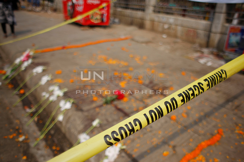 Bangladeshi activists puts flower on the place where prominent Bangladeshi-American blogger Avijit Roy was hacked to death. Friday, Feb. 27, 2015.