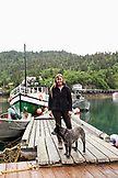 USA, Alaska, Homer, Marian Beck, the owner of the Saltry restaurant with her dog Pico, Halibut Cove