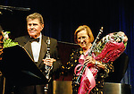 MERRICK - NOV. 13: Stanley Drucker, clarinetist; with (R) wife Naomic Drucker, with bouquet of flowers during curtain call after performing in concert presented by Merrick-Bellmore Community Concert Association, November 13, 2010, in Merrick, NY, USA