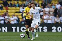 Jay Fulton of Swansea City is closely marked by Etienne Capoue of Watford the Premier League match between Watford and Swansea City at Vicarage Road Stadium, Watford, England, UK. Saturday 15 April 2017