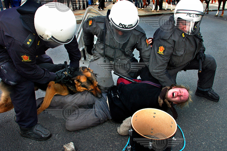 Oslo, Norway 2003:  He was playing drum for peace but ended up with a police dog in his leg. A protest against the American invasion of Iraq ended with riots.