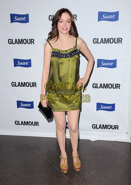 ROSE McGOWAN.The Glamour Reel Moments held at The DGA in West Hollywood, California, USA. .October 14th, 2008                                                                     .full length green silk satin dress clutch bag platform shoes black yellow hand on hip .CAP/DVS.©Debbie VanStory/Capital Pictures.
