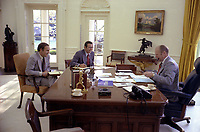 Photograph of President Gerald R. Ford meeting with Chief of Staff Donald Rumsfeld and Dick Cheney in the Oval Office.  22 April 197