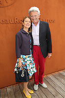 Nelson Monfort and wife seen at 'Le Village de Roland Garros' during Roland Garros tennis open 2016 on may 25 2016.