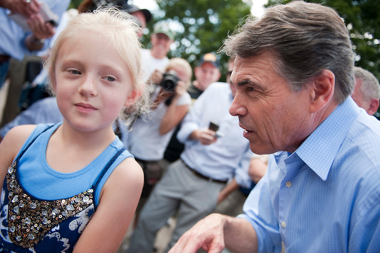 UNITED STATES - AUGUST 15:  Republican presidential candidate Texas Gov. Rick Perry, right, greets Emma Rickertsen, 7, of St. Charles, Ill., at the Iowa State Fair in Des Moines, Iowa.  (Photo By Tom Williams/Roll Call)