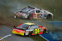 Nov. 1, 2009; Talladega, AL, USA; NASCAR Sprint Cup Series drivers Jeff Gordon (24) and Scott Speed (82) crash during the Amp Energy 500 at the Talladega Superspeedway. Mandatory Credit: Mark J. Rebilas-