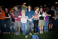 OccupyBoston protesters link arms around the tents in preparation for a planned police action at their second encampment at Rose F. Kennedy Greenway a block from Dewey Square, in downtown Boston, Massachusetts, USA.  The police and city officials warned protesters that they would be forceably removed from the site by midnight.  At about 1:30am police moved into the park, arrested approximately 100 protesters, and cleared the park of all tents and other protest materials.  The protesters are part of OccupyBoston, which is part of the OccupyWallStreet movement, expressing discontent with the socioeconomic situation of the 99% of the US population who are not wealthy.  Protestors have been camping in Dewey Square since Sept. 30, 2011. Gradually, larger organizations, including major labor unions, have expressed their support for the OccupyBoston effort.
