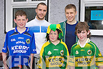 Patrick Horan, Tommy Regan, Dylan Browne with Kerry players Paddy Curtin and Peter Crowley  at the Castleisland Boys NS Active flag raising on Thursday..