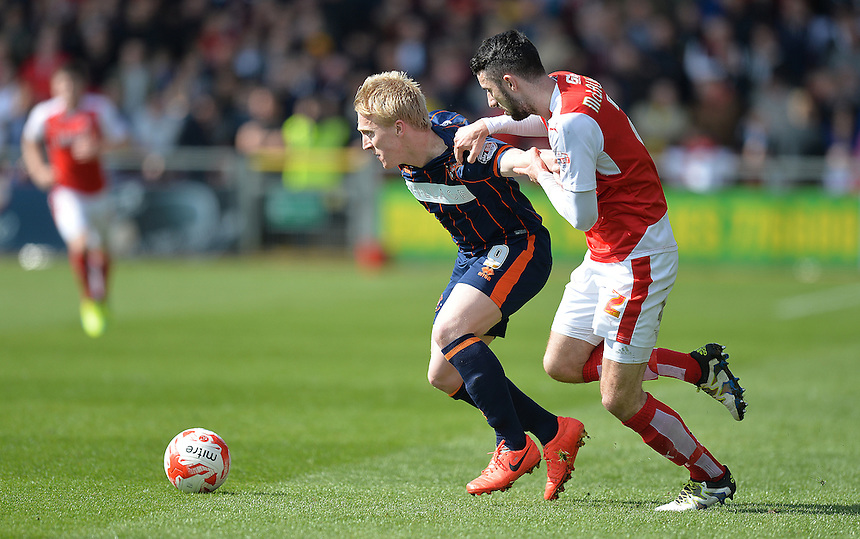 Blackpool's Mark Cullen and Fleetwood Town's Conor McLaughlin battle for the ball <br /> <br /> Photographer Dave Howarth/CameraSport<br /> <br /> Football - The Football League Sky Bet League One - Fleetwood Town v Blackpool - Saturday 23rd April 2016 - Highbury Stadium - Fleetwood  <br /> <br /> &copy; CameraSport - 43 Linden Ave. Countesthorpe. Leicester. England. LE8 5PG - Tel: +44 (0) 116 277 4147 - admin@camerasport.com - www.camerasport.com