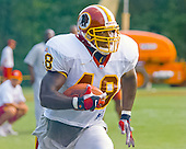 Washington Redskins running back Stephen Davis (48) carries the ball during a drill at the team's training camp at Redskins Park in Ashburn, Virginia on August 10, 2000.<br /> Credit: Arnie Sachs / CNP
