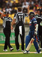 Ross Taylor congratulates NZ captain Daniel Vettori for dismissing India's Sachin Tendulkar (right) lbw during the 2nd ODI cricket match between the New Zealand Black Caps and India at Westpac Stadium, Wellington, New Zealand on Friday, 6 March 2009. Photo: Dave Lintott / lintottphoto.co.nz