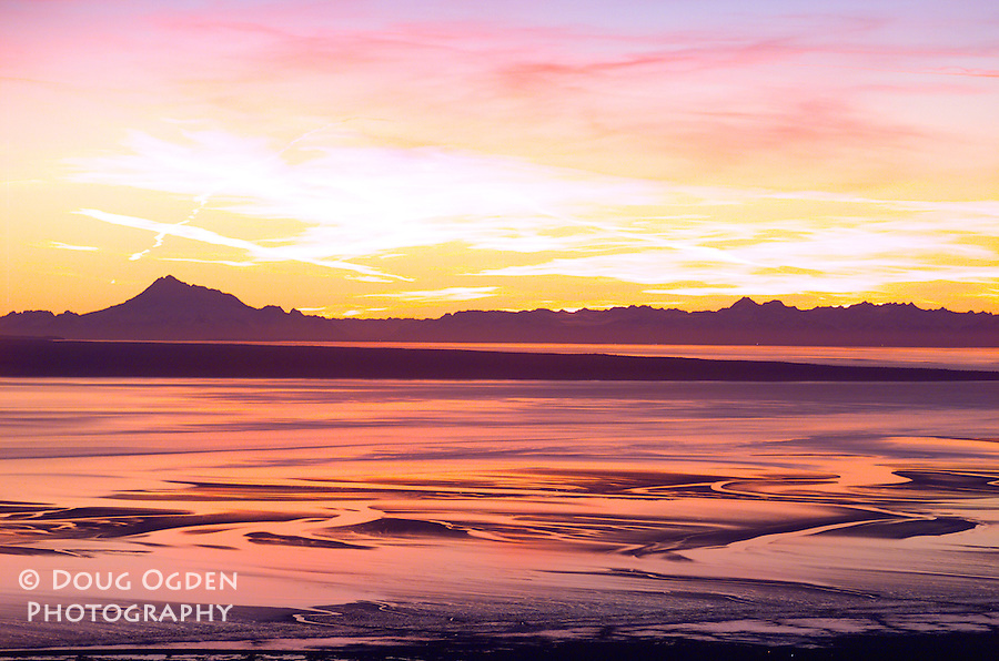 Sunset over Cook Inlet, Alaska.  Mount  Redoubt and the Alaska Range.