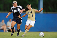 27 August 2011:  FIU's Ashleigh Shim (9) moves the ball downfield while being pursued by Akron's Liz Cloutier (28) in the first half as the University of Arkon Zips faced off against the FIU Golden Panthers at University Park Stadium in Miami, Florida.
