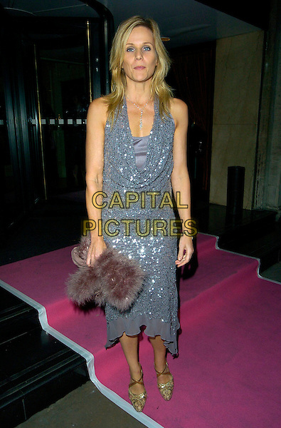 LINDA BARKER.Leaving the Breast Cancer Care Evening Fashion Show, Grosvenor House Hotel, London, England..October 4th, 2007.full length grey gray silver dress sequins sequined cowel neck gold shoes  .CAP/CAN.©Can Nguyen/Capital Pictures