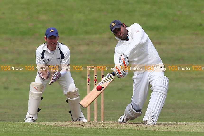Ardleigh Green lose their eighth wicket, Sajid Younis - Ardleigh Green CC vs Woodford Wells CC - Essex Cricket League - 31/05/14 - MANDATORY CREDIT: Gavin Ellis/TGSPHOTO - Self billing applies where appropriate - 0845 094 6026 - contact@tgsphoto.co.uk - NO UNPAID USE