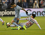 Felipe Gutierrez of Sporting KC (left) and Pablo Barrientos of Toluca vie for the ball during their CONCACAF Champions League game on February 21, 2019 at Children's Mercy Park in Kansas City, KS.<br /> Tim VIZER/Agence France-Presse