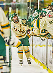 14 December 2013: University of Vermont Catamount Forward and Team Co-Captain Chris McCarthy, a Senior from Collegeville, PA, is congratulated as he skates along the bench after scoring Vermont's 4th goal against the Saint Lawrence University Saints in the third period at Gutterson Fieldhouse in Burlington, Vermont. The Catamounts defeated their former ECAC rivals, 5-1 to notch their 5th straight win in NCAA non-divisional play. Mandatory Credit: Ed Wolfstein Photo *** RAW (NEF) Image File Available ***