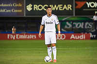 Cristiano Ronaldo (7) of Real Madrid stands over the ball prior to a free kick. Real Madrid defeated A. C. Milan 5-1 during a 2012 Herbalife World Football Challenge match at Yankee Stadium in New York, NY, on August 8, 2012.