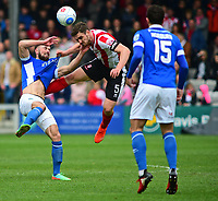 Lincoln City's Luke Waterfall vies for possession with Macclesfield Town's Chris Holroyd<br /> <br /> Photographer Andrew Vaughan/CameraSport<br /> <br /> Vanarama National League - Lincoln City v Macclesfield Town - Saturday 22nd April 2017 - Sincil Bank - Lincoln<br /> <br /> World Copyright &copy; 2017 CameraSport. All rights reserved. 43 Linden Ave. Countesthorpe. Leicester. England. LE8 5PG - Tel: +44 (0) 116 277 4147 - admin@camerasport.com - www.camerasport.com