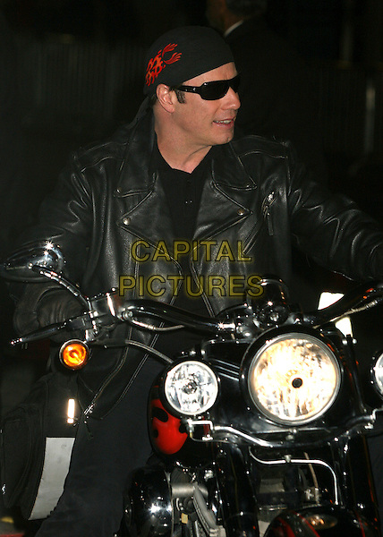 "JOHN TRAVOLTA.""Wild Hogs"" Los Angeles Premiere at the El Capitan Theatre, Hollywood, California, USA..February 27th, 2007.half length sunglasses shades bandana motorcycle bike black leather jacket .CAP/ADM/BP.©Byron Purvis/AdMedia/Capital Pictures"