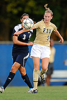 27 August 2011:  FIU's Johanna Volz (5) gets to a loose ball ahead of Akron's Jordan Clark (3) in the first half as the FIU Golden Panthers defeated the University of Arkon Zips, 1-0, at University Park Stadium in Miami, Florida.