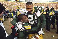 "Dorsey Levens congratulates Reggie White as the Green Bay Packers defeat the Carolina Panthers in the NFC Championship game at Lambeau Field and advance to the team's first return to the Super Bowl in 29 years. This was the first title game in Green Bay since the ""Ice Bowl"" in 1967."