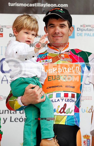 Pablo Urtasun (Euskaltel Euskadi team) with his son celebrates winning the first stage of the Castilla and Leon 2013 Cycling Tour. The first stage of the 28th tour took place from Arevalo (Avila) to Valladolid. April 12, 2013. Valladolid, Spain. (Alterphotos/Victor J Blanco) /NortePhoto
