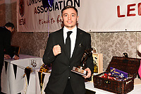 Sunny Edwards with the Johnny Kent Trophy for best London prospect during the London Ex-Boxers Association Awards Lunch at the Grand Connaught Rooms on 16th February 2020