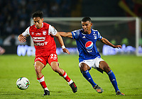 BOGOTA, COLOMBIA - MARCH 03: Fabian Sambueza of Santa Fe fights for the ball  against Omar Bertel of Millonarios during the match between Millonarios and Independiente Santa Fe as part of the Liga BetPlay at Estadio El Campin on March 3, 2020 in Bogota, Colombia. (Photo by John W. Vizcaino/VIEW press/Getty Images)
