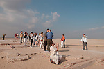 CAIRO - NOVEMBER 30, 2004 : Hordes of foreign and egyptian tourists visit the 5000 years old Giza pyramids in Cairo, on November 30, 2004. Sitauated high on a desert plateau overlooking sprawling Cairo, Giza is the most visited tourist site in Egypt ,with the Sphinx and the 481ft high great Pyramid. Tourism has been on the decline in Egypt following a series of terrorist attacks targeting foreign tourists. (Photo by Jean-Marc Giboux)