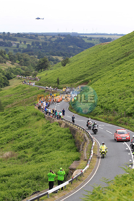 The breakaway group climb the first climb of the day at Cote de Blubberhouses start of Stage 2 of the 2014 Tour de France running 200km from York to Sheffield. 6th July 2014.<br /> Picture: Eoin Clarke www.newsfile.ie