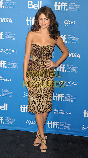 Selena Gomez.'Spring Breakers' photocall  - 2012 Toronto International Film Festival held at Ryerson Theatre. Toronto, Ontario, Canada, 6th September 2012..full length strapless leopard print dress hand on hip  strappy sandals .CAP/ADM/BPC.©Brent Perniac/AdMedia/Capital Pictures.