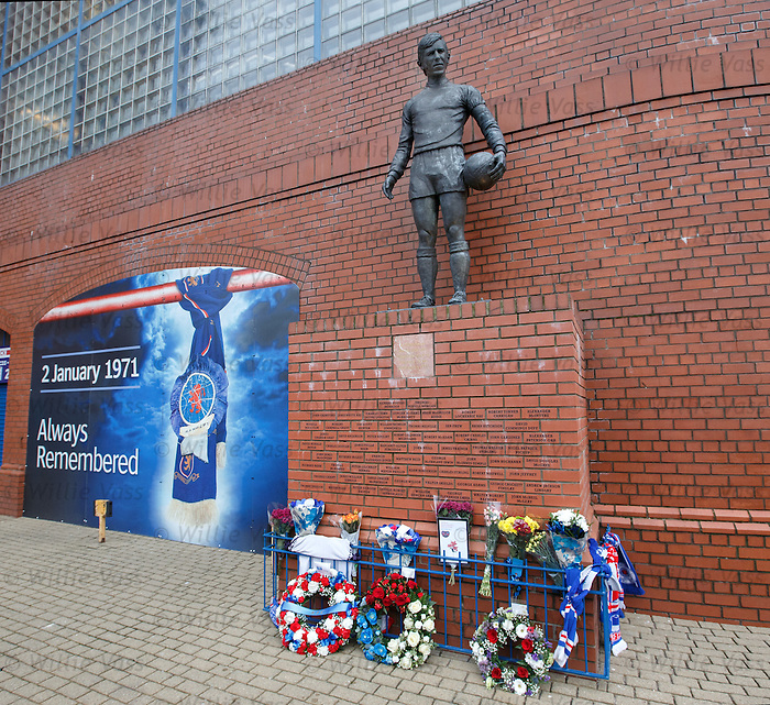 Flowers and wreaths at the memorial statue at Ibrox Stadium today