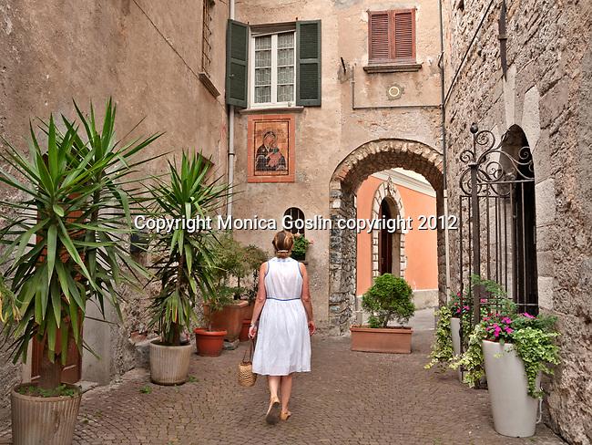 Stone houses and cobble stone street in Mandello del Lario, a town on Lake Como