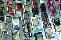 "MP3 models are displayed in the showroom of Zhuhai Aimei Electronic Technology Co., Ltd. which is a MP3 and MP4 factory in Zhuhai city , Guangdong Province, China. MP3 players are coveted items among young adults in China. Students and young professionals rank a MP3 at top of their ""must buy"" electronics list in 2006. ."
