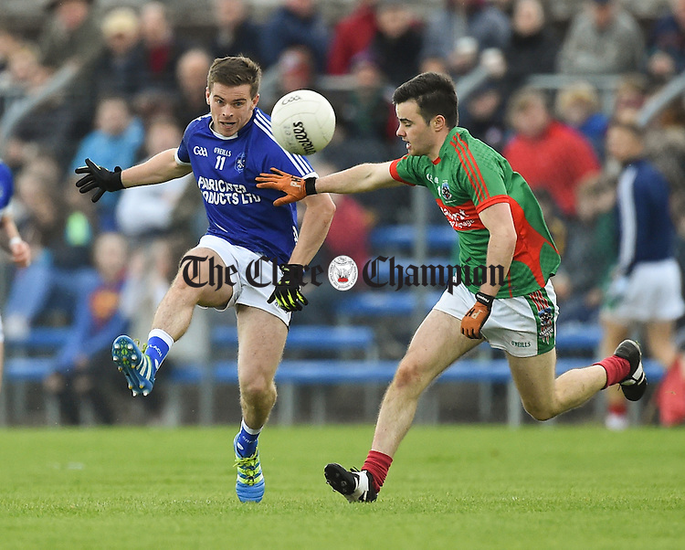Sean Collins of  Cratloe in action against Ciaran Morrissey of Kilmurry Ibrickane during their senior football final replay at Cusack park. Photograph by John Kelly.