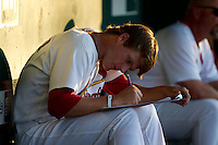 Shelby Miller (26) of the Springfield Cardinals works on paperwork in the dugout during a game against the Tulsa Drillers at Hammons Field on July 19, 2011 in Springfield, Missouri. Tulsa defeated Springfield 17-11. (David Welker / Four Seam Images)