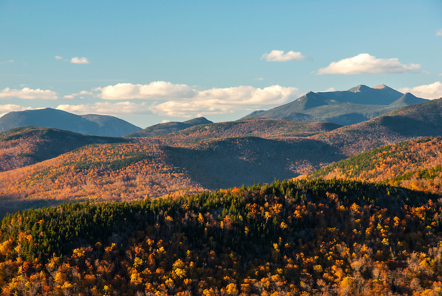 The rugged Franconia Range and Cannon Mountain loom large in this autumn landscape of the New Hampshire White Mountains.
