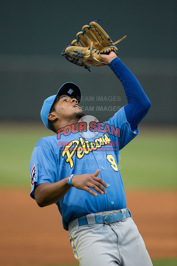 Myrtle Beach Pelicans third baseman Jeimer Candelario (9) catches a foul pop fly during the game against the Winston-Salem Dash at BB&T Ballpark on April 18, 2015 in Winston-Salem, North Carolina.  The Pelicans defeated the Dash 8-4 in game two of a double-header.  (Brian Westerholt/Four Seam Images)