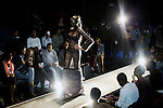 SOWETO, SOUTH AFRICA MAY 29: A Model for the designer Inventive Fashion by Zamaswazi walks with a garment during a fashion show at Soweto Fashion Week on May 29, 2014 at the Soweto Theatre in the Jabulani section of Soweto, South Africa. Local emerging designers showed their collections during the three-day event held at the theatre. Founded in 2012, Soweto fashion week gives a platform to local designers, models and artists. (Photo by: Per-Anders Pettersson)