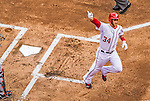 1 April 2013: Washington Nationals outfielder Bryce Harper crosses the plate after hitting a solo home run during his first at-bat giving the Nationals a 1-0 lead in the Opening Day Game against the Miami Marlins at Nationals Park in Washington, DC. Harper hit a second homer during his second plate appearance and was named Player of the Game as the Nationals defeated the Marlins 2-0 to launch the 2013 season. Mandatory Credit: Ed Wolfstein Photo *** RAW (NEF) Image File Available ***