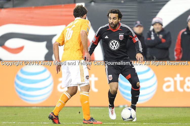 18 November 2012: DC's Dwayne De Rosario (CAN) (7) is defended by Houston's Adam Moffat (SCO) (16). DC United played the Houston Dynamo at RFK Stadium in Washington, DC in the second leg of their 2012 MLS Cup Playoffs Eastern Conference Final series. The game ended in a 1-1 tie, Houston won the series 4-2 on aggregate goals.